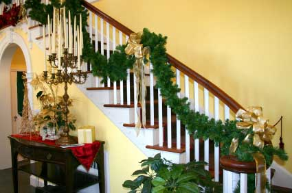 Staircase design - Timber is a very popular material used in stair construction, for the treads and the balusters and handrails shown here, and decorated for Christmas!