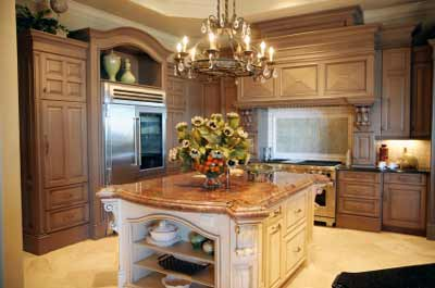 Luxury kitchen - The central chandelier candelabra light fitting combines with the island and works well with the coffered ceiling, acting as a focal point to the centre of the room while giving an allover functional wash of light to the central island's workbench.