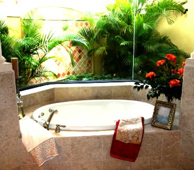 Look out the window her, the green foliage just brightens up a cool and dull bathroom.
