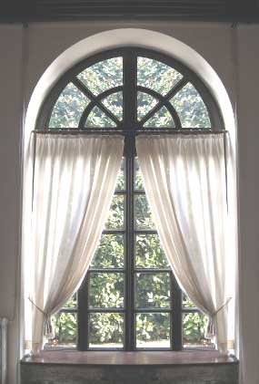 recessed palladian window with sheer curtains