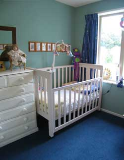 Blue green baby's nursery walls