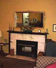 Mirrors create an ever changing piece of artwork over a fireplace.