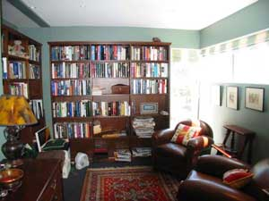 Dramatic, the books add a lot of texture and movement into the redecorated  space.