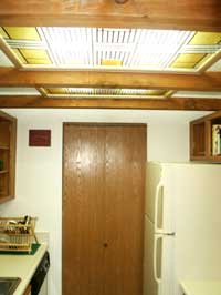 This method using beams and frames has effectively lowered the ceiling, but produced more light.