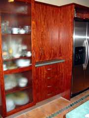 Uses of Wood - Timber Veneer to Cupoard Doors in Kitchen