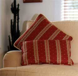 Red suggests luxury, great to use as an accent in a living room with cushions.
