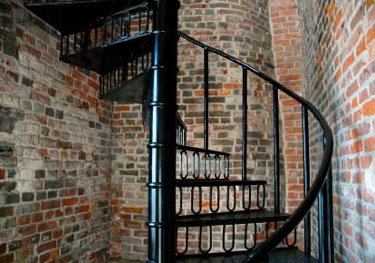 Steel spiral staircase in a tight brick stairwell - Spiral staircase wrought iron ...